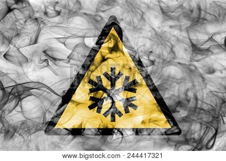 Low Temperatures Hazard Warning Smoke Sign. Triangular Warning Hazard Sign, Smoke Background.