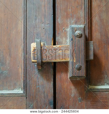 Closeup Of A Wooden Aged Latch Over An Ornate Wooden Door, Cairo, Egypt