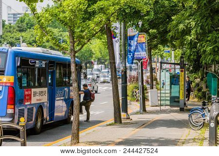 Daejeon, South Korea; June 8,2018: Unidentified Asian Man Boards City Bus From Bus Stop On Busy Stre