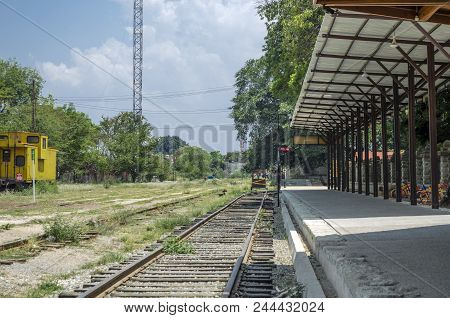Oaxaca, Oaxaca, Mexico- June 1, 2018: Landscape With Tracks And A Yellow Carriage In A Sunny Day At