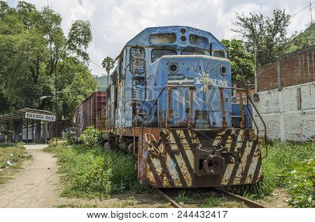 Oaxaca, Oaxaca, Mexico- June 1, 2018: Old Rusty Blue Train In A Sunny Day At Ferrocarril Museum In O