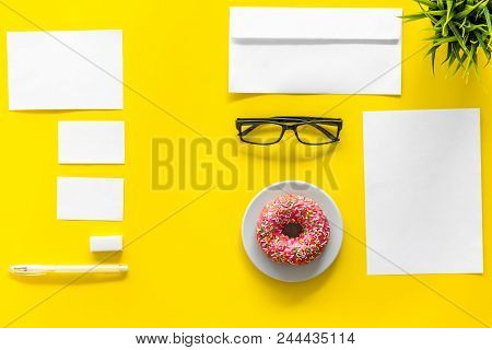 Come Up With Brand Identity. Blank Stationery For Branding Near Coffee And Donut On Yellow Backgroun