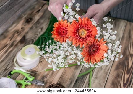 Florist At Work. Female Hands Collect A Wedding Bouquet. People Behind The Work Concept. The Workpla