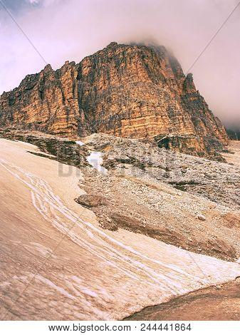 Tre Cime Di Lavaredo Rocks  Hidden In Gentle Fog. Early Summer Trip In Dolomites In Italy.