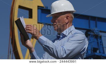 Petroleum Engineer Working In Extracting Oil Industry Using Agenda