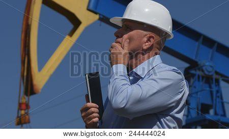 Petroleum Engineer Working In Extracting Oil Industry Use Agenda Looking Worried