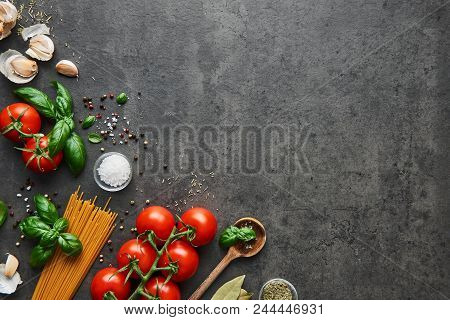 Food Background For Tasty Italian Dishes With Tomato. Various Cooking Ingredients With Spaghetti And