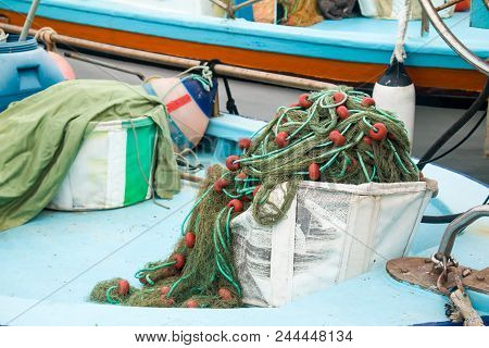 Ship Tackle. Nautical Background. Old Fishnet And Rope