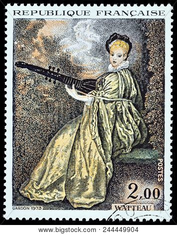 Luga, Russia - June 07, 2018: A Stamp Printed By France Shows Painting Lady Playing Archlute (la Fin