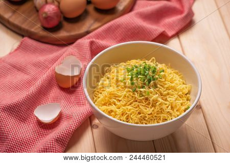 Instant Noodles In Bowl With Vegetable. A Bowl Of Instant Noodles On Wooden Table