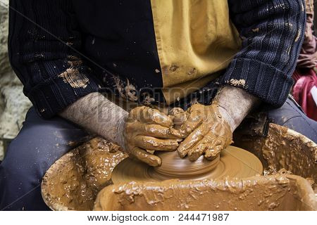 Hands Of Man Working And Shaping Clay, Potter In Pottery