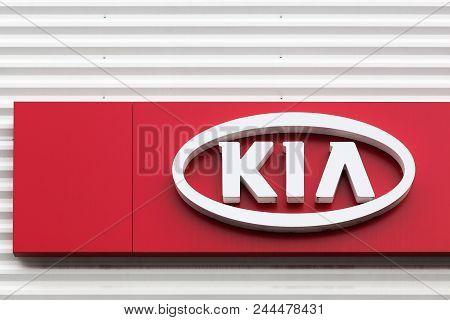 Macon, France - May 27, 2018: Kia Motors Logo On A Wall Of A Dealership. Kia Motors Corporation Head
