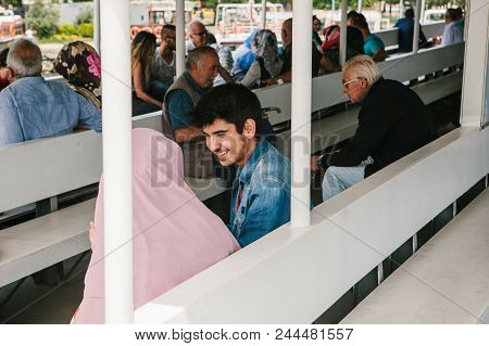 Istanbul, June 17, 2017: A Young Couple Of Man And Woman Sailing On A Ferry Or Passenger Boat And Ta
