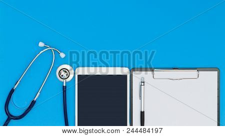 Stethoscope With Clipboard And Tablet, Medical Equipment On A Light Blue Background