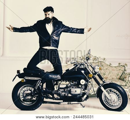 Hipster Biker Brutal In Leather Jacket On Motorcycle Enjoying Richness. Superiority Concept. Man, Be