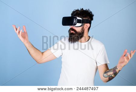 Man With Hipster Beard In Vr Goggles Impressed By Multidimensional Video, 3d Experience Concept. Bea