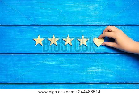 Four Stars And Heart On A Blue Background. Rating Five Stars, The Choice Of The Editorial Office And