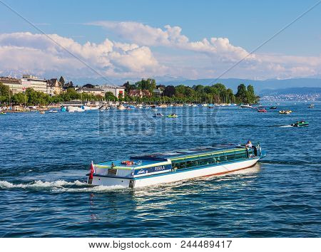 Zurich, Switzerland - May 11, 2018: Lake Zurich, Summits Of The Alps In The Background, View From Th