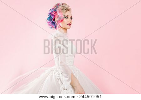 Cool Young Woman With Colored Hair. Stylish Hairstyle, Informal Style. Pink Background