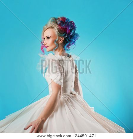 Cool Young Woman With Colored Hair. Stylish Hairstyle, Informal Style. Blue Background