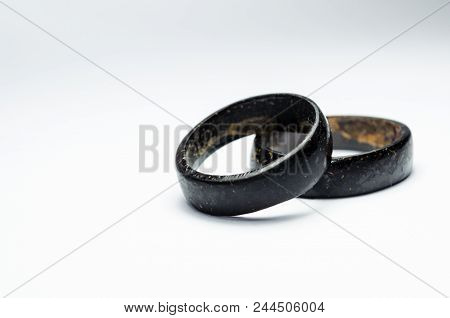 Pair Of Coconut Rings Together On A White Background. Intense Black Tone. Handicraft Common In The N