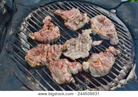 Meat Grilled On An Outdoor Grill . South Bohemia