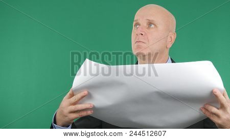 Businessperson Reading A Construction Plan With Green Screen In Background