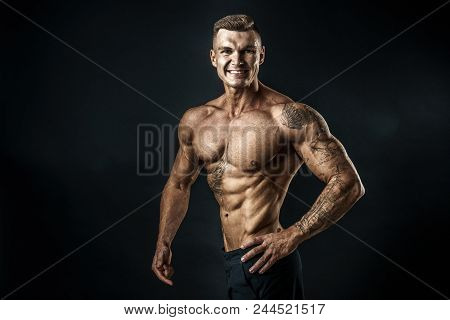 Strong Bodybuilder With Six Pack. Bodybuilder Man With Perfect Abs, Shoulders, Biceps, Triceps And C