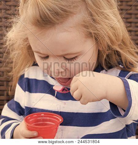 Child Eats Ice Cream. Kid With Frozen Fruit Yogurt, Gelato Or Sorbet. Food, Refreshing Dessert Eatin