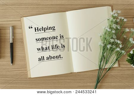 Motivational And Inspirational Quote. Wisdom Quote. Notebook With Flower On Wood Background With Quo
