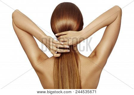 Healthy Shiny Long Hair In Tale. Beautiful Girl Holding Her Hair In Hand. Back View On White. Hairst