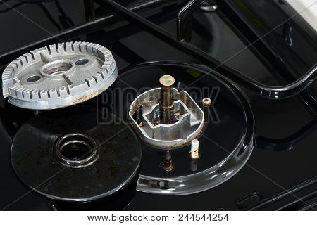 Disassembled Gas Range Parts And A Temperature Sensor For Fire Prevention