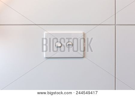 Modern Double Light Switch On White Tiles Wall With Copy Space
