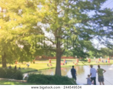 Abstract Blurred Family With Kids Fishing In Pond In Summer