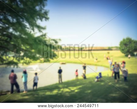 Vintage Blurred Family With Kids Fishing In Pond In Summer