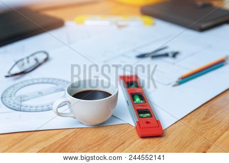 Engineer And Architect Concept, Closeup Coffee On Desk With Blueprints