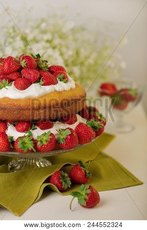 Homemade Strawberry Cake With Cream On A Glass Stand. Selective Focus.