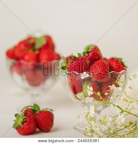 Strawberries In A Jelly Glass On A White Background. Selective Focus.