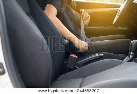Transportation And Vehicle Concept,close Up Of Woman Hands Fastening Or Putting Seat Belt In Car,tra