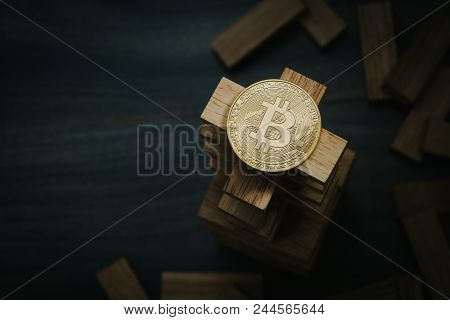 Bitcoin On The Wooden Building Blocks Tower. Concept For Bitcoin Risk,  Also Can Use As  Building Bi