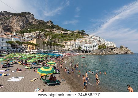 Amalfi, Italy - June 16, 2017: People Are Resting On A Sunny Day At The Beach In Amalfi On Amalfi Co