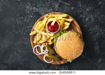 Burger, Hamburger Or Cheeseburger Served With French Fries, Pickles And Onion On Wooden Board. Top V