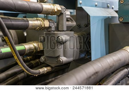 Rubber Hydraulic Hoses, Connected To Industrial Equipment. Abstract Industrial Background.
