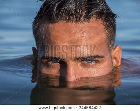 Attractive Young Shirtless Athletic Man Standing In Water In Sea Or Lake, With Half Face Submerged U