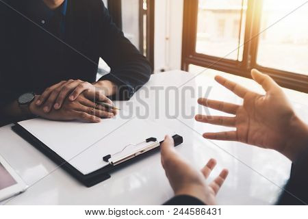 Close Up Of Executive Hand During Interview. Examiner Reading A Resume During A Job Interview, Emplo
