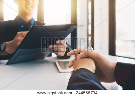 Executive Hand During Interview. Examiner Reading A Resume During A Job Interview, Employment And Re