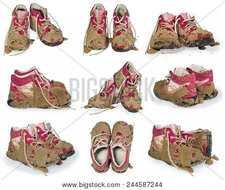 Children's Tiny Shoes Covered With Mud. Dirty Leggings For Children's Feet In Raspberry.