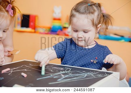Group Of Children Boy And Two Girls Draw Chalk On Blackboard With Hands, Concept Preparation For Sch