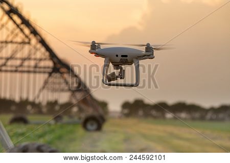 Drone Flying In Front Of Irrigation System In Field