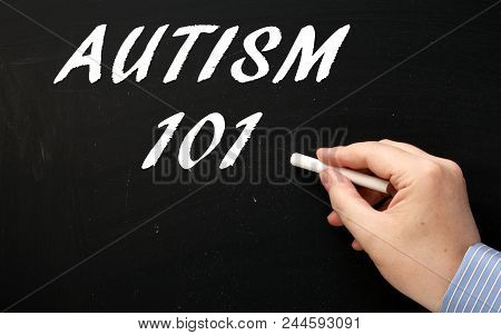 Hand Writing The Words Autism 101 On A Blackboard As An Introduction To The Mental Health Condition